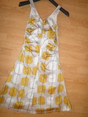 Sukienka Reserved wzory geometryczne kwiaty klosz